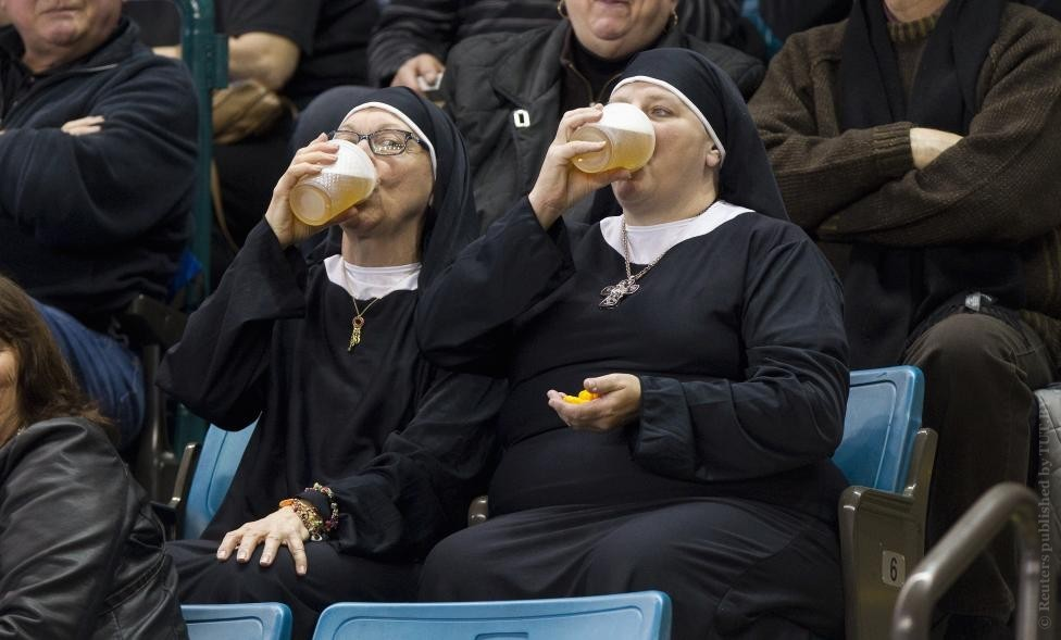 Kamloops, British Columbia: Although some people might conclude that a curling event could produce a dull atmosphere, it is actually far from it. Some of the most energetic and loyal fans are committed to showing their colours at tournaments around the world. There was a lull in the games that were being held on this day and I remember spotting these nuns sitting in their seats earlier. Although them just sitting there didn't produce a picture, I kept my eye on them for the entire match. As soon as I spotted them with beer in their hands, I slowly turned my camera towards them and waited for them to take a drink. One of the challenges of shooting this image was to not have everyone notice me taking the photo. I had a longer lens on and was right in the middle of the rink. I slowly turned my lens, not to make my intentions too obvious, and waited until they drank from their beers together. Caption: Two women wearing nun outfits drink beer while watching the 2014 Tim Hortons Brier curling championships in Kamloops, British Columbia, March 8, 2014. REUTERS/Ben Nelms