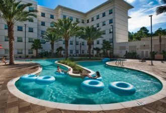 JON M. FLETCHER/The Times-Union -- 092109 --  Students float along the lazy river at the new Osprey Fountains dorm complex on the University of North Florida campus, Tuesday, September 22, 2009. (The Florida Times-Union, Jon M. Fletcher)