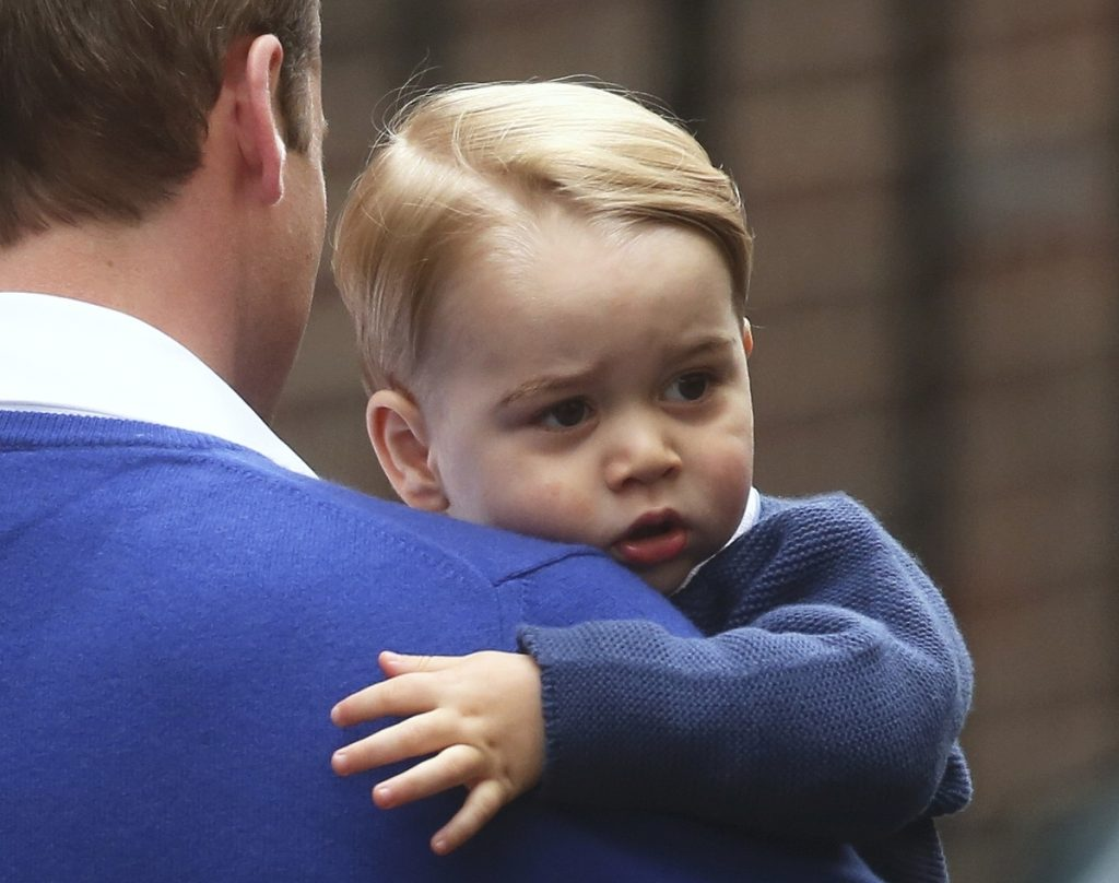 Britain's Prince William returns with his son George to the Lindo Wing of St Mary's Hospital, after the birth of his daughter in London, Britain May 2, 2015. Britain's Duchess of Cambridge, has given birth to a daughter, the couple's residence Kensington Palace announced on Saturday. REUTERS/Neil Hall