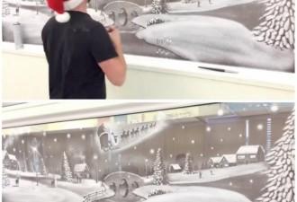 Художник рисует снегом на окнах детской больницы