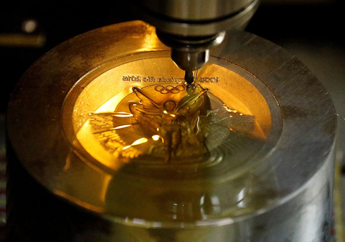 A machine works on a Rio 2016 Olympic medal at the Casa da Moeda do Brasil (Brazilian Mint) in Rio de Janeiro, Brazil, June 28, 2016.  REUTERS/Sergio Moraes