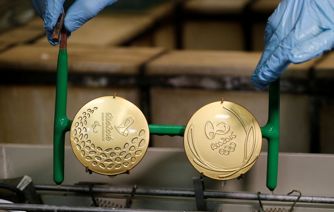 A worker from the Casa da Moeda do Brasil (Brazilian Mint) takes out gold-plated Rio 2016 Olympic and Paralympic medals in Rio de Janeiro, Brazil, June 28, 2016.  REUTERS/Sergio Moraes