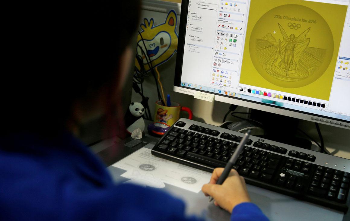 A sculptress from the Casa da Moeda do Brasil (Brazilian Mint) works on the Rio 2016 Olympic medal at her computer in Rio de Janeiro, Brazil, June 28, 2016.  REUTERS/Sergio Moraes