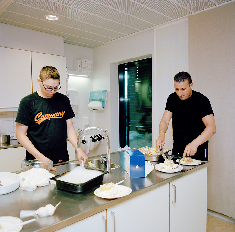 "Halden Prison, Norway, June 2014: Inmates named Reijo (left) and Yassin with cake that Yassin made for another inmate's birthday. The cake is called Kvæfjord kake, a favorite confection of spongecake, custard, and meringue topped with almonds and whipped cream known to Norwegians as the ""World's Best [Cake]."" -- No commercial use -- Photo: Knut Egil Wang/Moment/INSTITUTE"