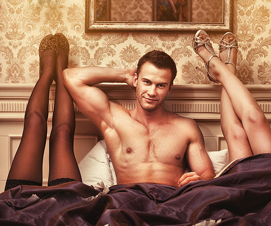 handsome young muscular man with two women in bedroom