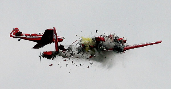Two acrobatic planes from the Zelazny group collide during a performance at an air show in Radom, Poland, in this Sept. 1, 2007, file photo. Both pilots died in the crash, but there were no reports of injuries in the crowd. (AP Photo/ Darek Redos/FILE)