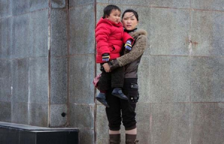 """Chen Xiaotian with his mother before he became ill A Chinese mum who nursed her dying son for two years even though she was seriously ill herself has been cured after doctors used the boy's kidney when he died to save her life. The tragic story started when Chen Xiaotian from Jinzhou city in Hubei province in central China was diagnosed as having a malignant brain tumour aged just five. He was treated and given an operation and for a few months it seemed that everything was well, but then the tumour returned with a vengeance and doctors told his parents there was little chance he would survive. In addition his mother Zhou Lu, 34, had been diagnosed as suffering from kidney failure that left her permanently ill and in need of dialysis treatment. Despite her illness however she continued to care for her son, taking him for regular treatment at the hospital as he gradually worsened. Eventually he became blind and shortly before he died had become bedridden and virtually paralysed, with his mother and grandmother having to do everything to care for him. Grandma Lu Yuanxiu, 57, said: """"The doctors approached me rather than his mother because of the sensitive nature of the issue. They told me that my grandson not survive but his kidneys could help his mother and also save to other lives as well. """"I discussed it with Zhou and she refused point-blank, she absolutely didn't want to hear any talk of that happening."""" But the Gran had enlisted the help of her grandson who had told his mother: """"I want to save your life."""" In tears, his mother had agreed to the doctor's proposal saying that what changed her mind was the thought that if her son was to die, part of him would live on in her. Doctors confirmed that the tissue match was perfect and when he died on April 2, he was quickly moved to the operating theatre where his kidneys and liver were removed donated to his mother and two other people. The second kidney went to a 21-year-old girl and his liver to a 27-year-old"""