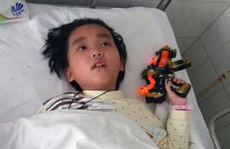 """Pictured: Chen Xiaotian A Chinese mum who nursed her dying son for two years even though she was seriously ill herself has been cured after doctors used the boy's kidney when he died to save her life. The tragic story started when Chen Xiaotian from Jinzhou city in Hubei province in central China was diagnosed as having a malignant brain tumour aged just five. He was treated and given an operation and for a few months it seemed that everything was well, but then the tumour returned with a vengeance and doctors told his parents there was little chance he would survive. In addition his mother Zhou Lu, 34, had been diagnosed as suffering from kidney failure that left her permanently ill and in need of dialysis treatment. Despite her illness however she continued to care for her son, taking him for regular treatment at the hospital as he gradually worsened. Eventually he became blind and shortly before he died had become bedridden and virtually paralysed, with his mother and grandmother having to do everything to care for him. Grandma Lu Yuanxiu, 57, said: """"The doctors approached me rather than his mother because of the sensitive nature of the issue. They told me that my grandson not survive but his kidneys could help his mother and also save to other lives as well. """"I discussed it with Zhou and she refused point-blank, she absolutely didn't want to hear any talk of that happening."""" But the Gran had enlisted the help of her grandson who had told his mother: """"I want to save your life."""" In tears, his mother had agreed to the doctor's proposal saying that what changed her mind was the thought that if her son was to die, part of him would live on in her. Doctors confirmed that the tissue match was perfect and when he died on April 2, he was quickly moved to the operating theatre where his kidneys and liver were removed donated to his mother and two other people. The second kidney went to a 21-year-old girl and his liver to a 27-year-old man. Hospital spokesman Yi"""